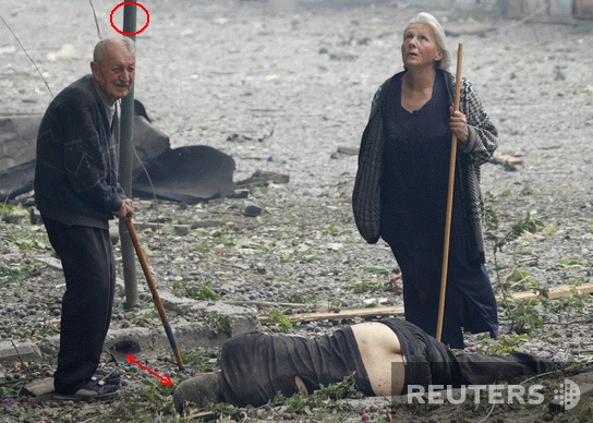 August 2008: Reuters images of alleged Georgian victims killed by Russian attacks: First film set near curbstone