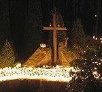 Hundreds_of_candles_and_a_Christian_Cross_at_a_cemetery_on_Christmas_eve