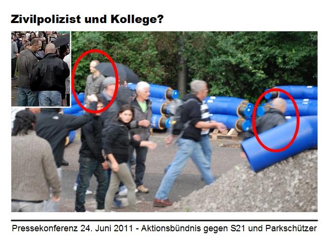 Stuttgart 21: Zivilpolizist I entfernt sich nach rechts, Zivilpolizist II nach links aus dem Bild